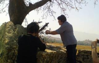 2 ladies praying at stones